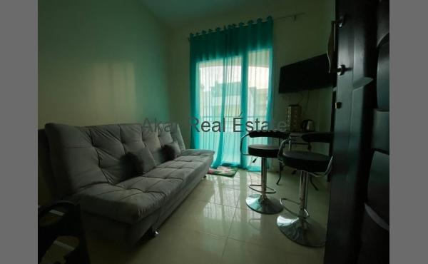 Квартира с одной спальней в доме с бассейном